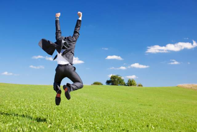 Energetic-Man-Suit-Happy-Jumping-For-Joy